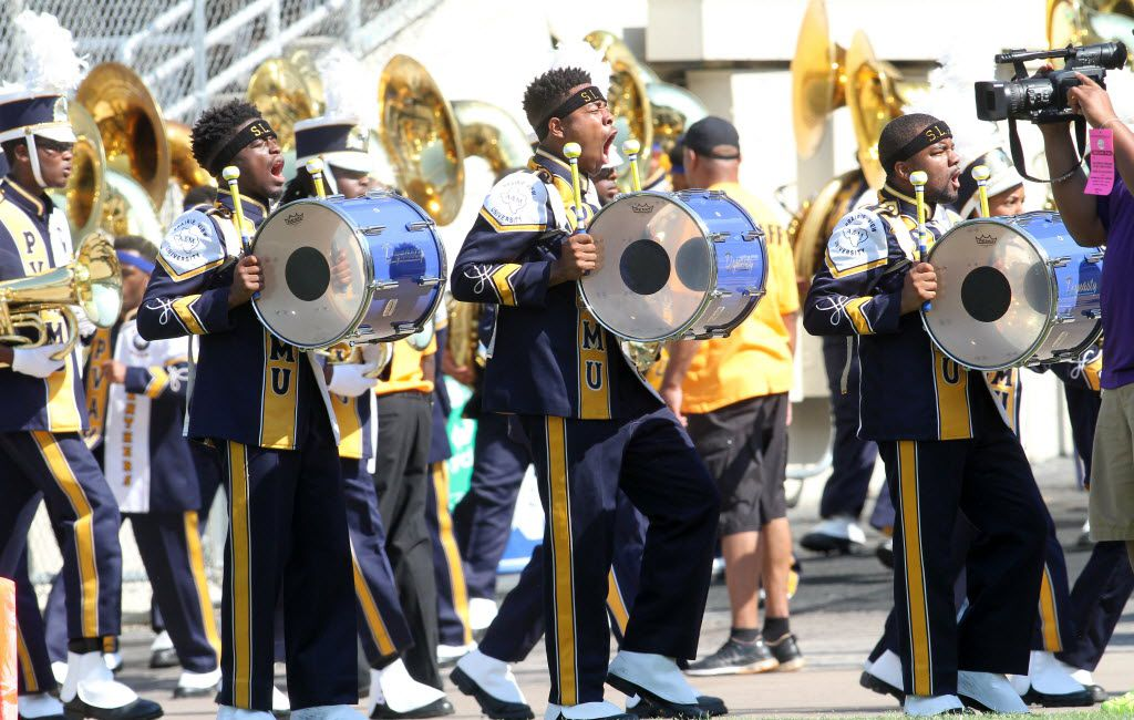Members of the Prairie View A&M percussion section arrive on the field of the Cotton Bowl prior to the start of the game between Grambling and Prairie View A&M. The two teams played in the annual State Fair Classic at the Cotton Bowl in Dallas on Sept. 26, 2015.