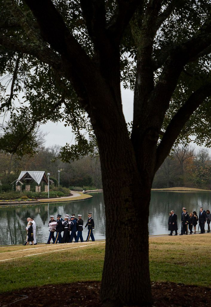 The flag-draped casket of President George H.W. Bush is followed by his family as he is carried to a burial plot close to his presidential library for internment on Thursday, Dec. 6, 2018, in College Station, Texas. (Smiley N. Pool/The Dallas Morning News)