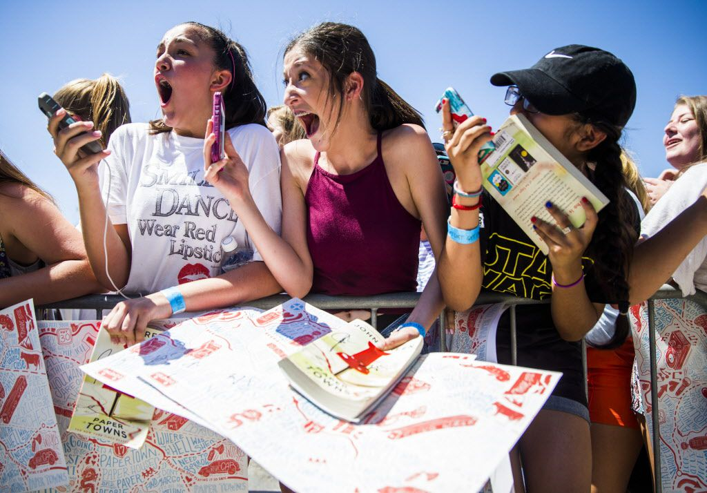 From left, Ariana Hickman, 14, Ashlyn Palmer, 15, and Melanie Faz, 13, react to seeing author John Green on the red carpet outside a promotional event for Paper Towns, a movie based on the book by John Green, on Thursday, July 16, 2015 at Bomb Factory in Dallas.