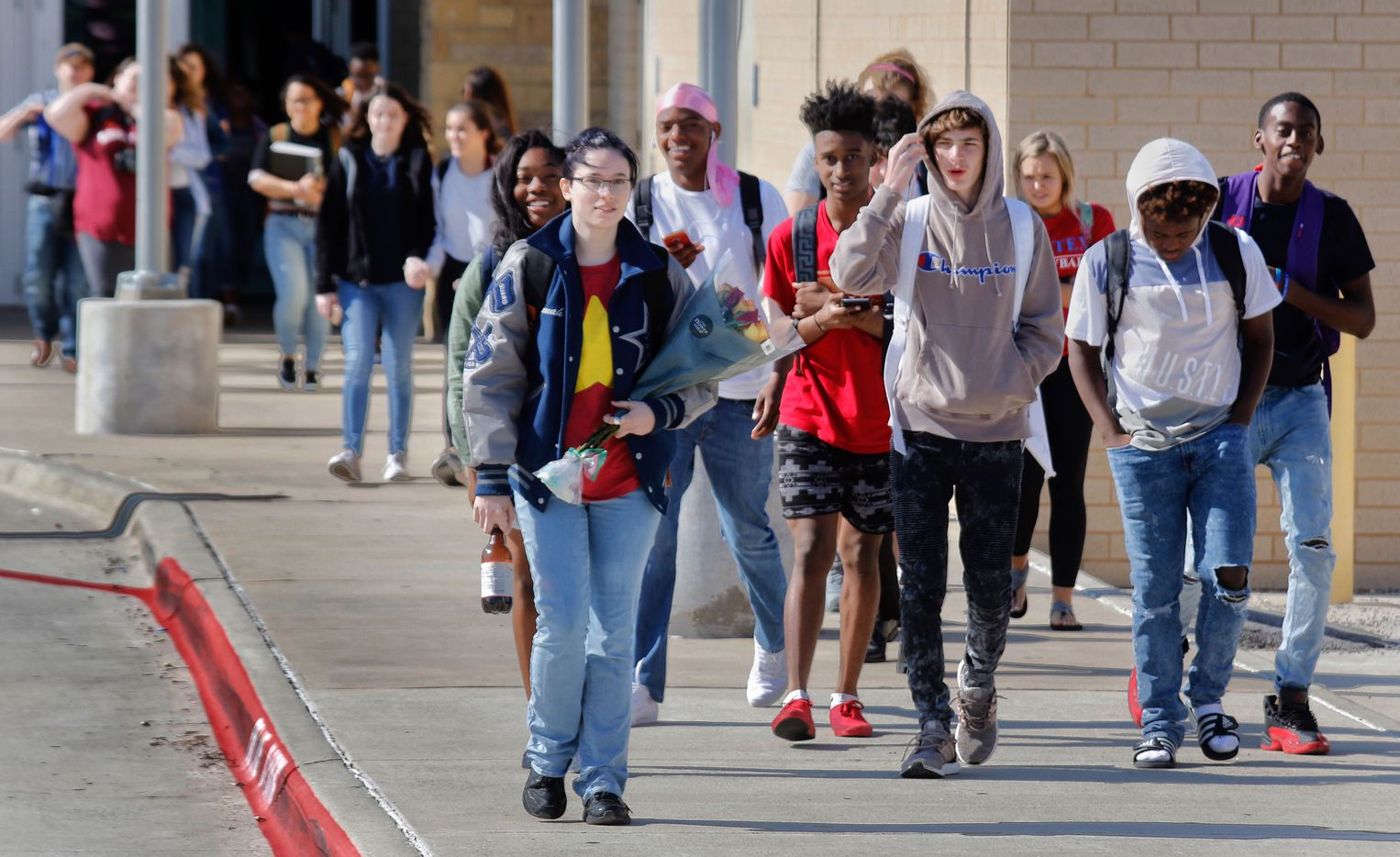Students at Frisco ISD Lone Star High School participate in the National School Walkout Friday morning April 20, 2018.