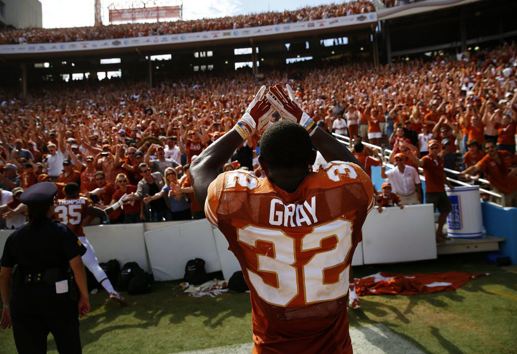 Texas Longhorns running back Johnathan Gray (32) celebrates with fans after beating the Oklahoma Sooners in the Red River Rivalry at the Cotton Bowl in Dallas, Saturday, October 12, 2013. Texas upset No. 12 Oklahoma, 36-20.  (Tom Fox/The Dallas Morning News)