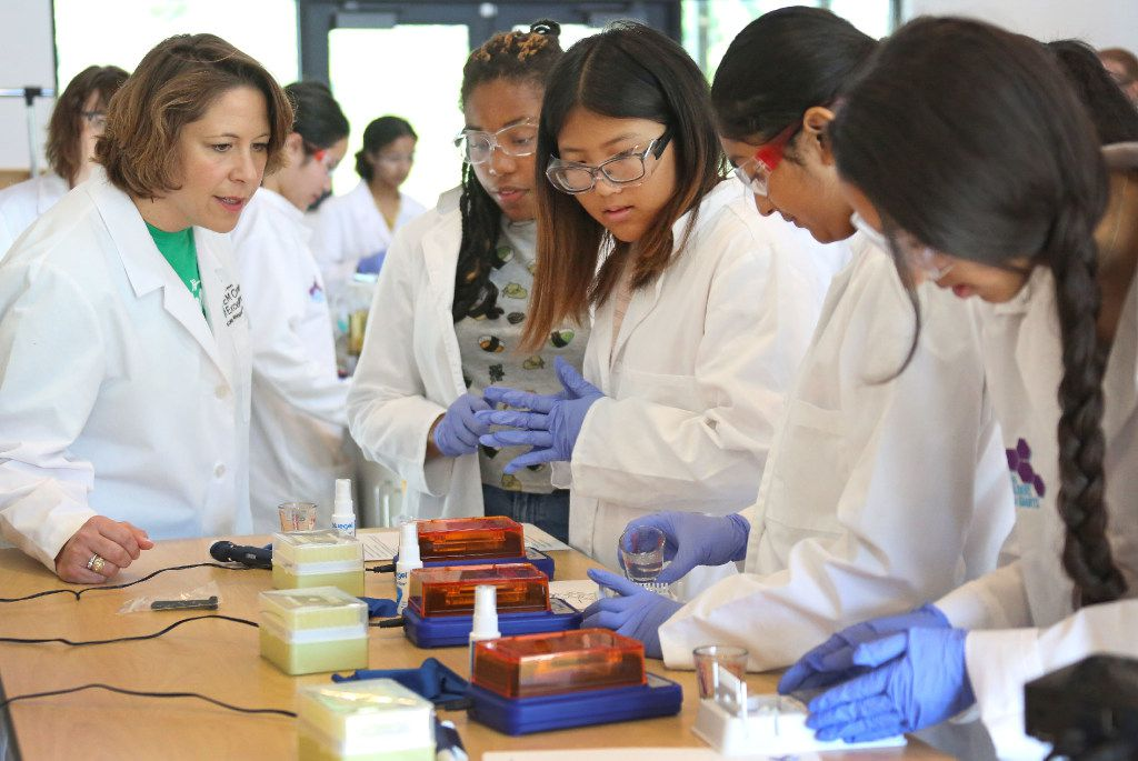 Northeast Texas Girl Scouts CEO Jennifer K. Bartkowski, left, watches as high school age girls gain hands-on experience in pharmaceutical discovery and development  during a class at the Girl Scout summer camp at Camp Whispering Cedars in Dallas, photographed on Thursday, July 20, 2017. (Louis DeLuca/The Dallas Morning News)