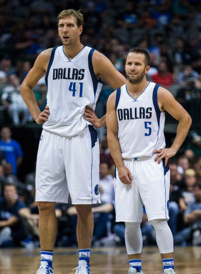 Dallas Mavericks forward Dirk Nowitzki (41) and Dallas Mavericks guard J.J. Barea (5) watch as a call is made during the first quarter of their preseason NBA game against the Oklahoma City Thunder on Tuesday, October 11, 2016 at the American Airlines Center in Dallas.