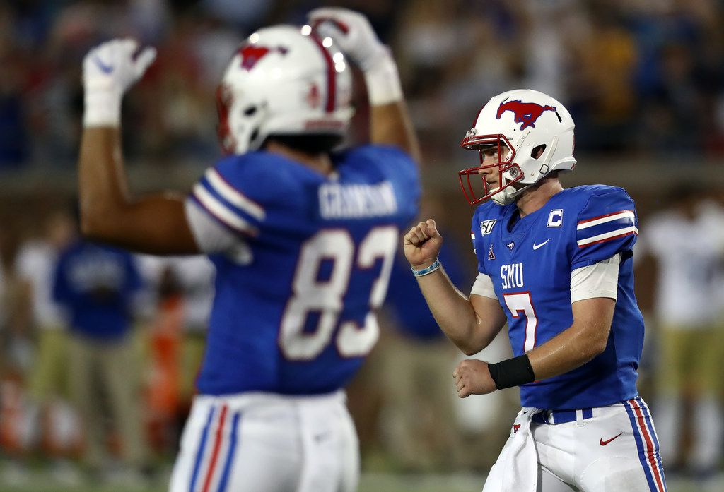 Shane Buechele (7) and Kylen Granson of the Southern Methodist Mustangs celebrates a touchdown against the Tulsa Golden Hurricane in the fourth quarter at Gerald J. Ford Stadium on Oct. 05, 2019 in Dallas.