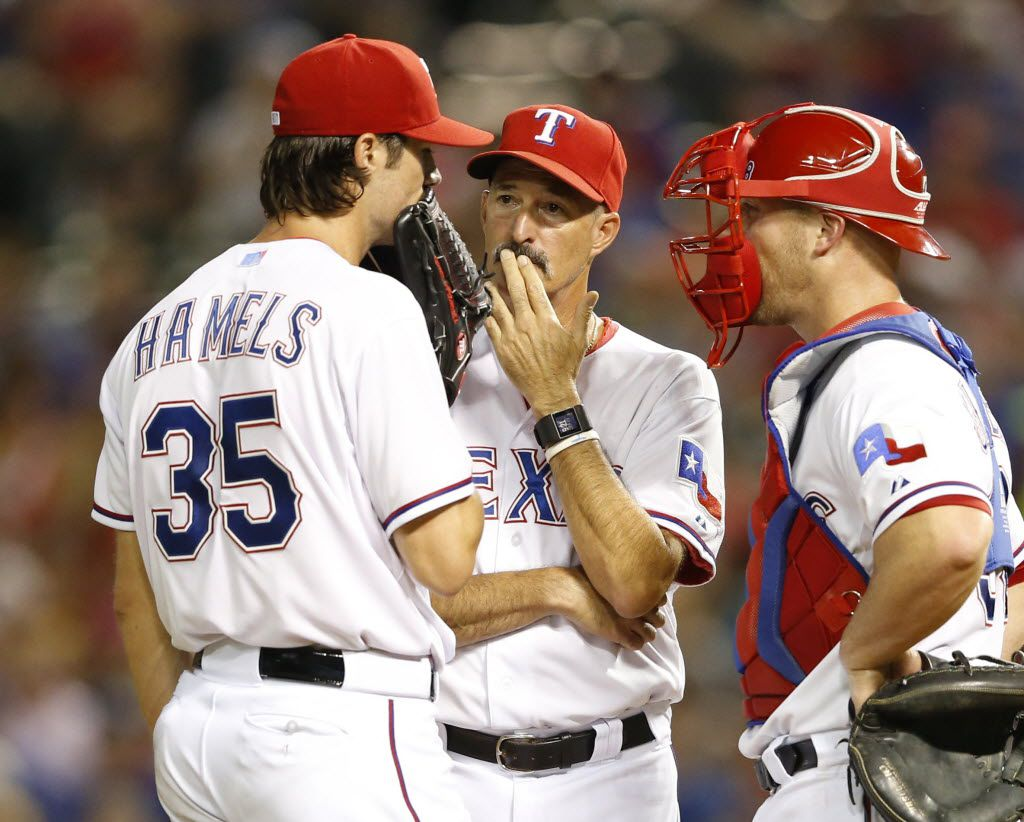 Former Rangers pitching coach Mike Maddux (center) will take his philosophy, his shoulder rubs and his Black Bart mustache and soul patch to the Washington Nationals pitching staff. (Vernon Bryant/The Dallas Morning News)