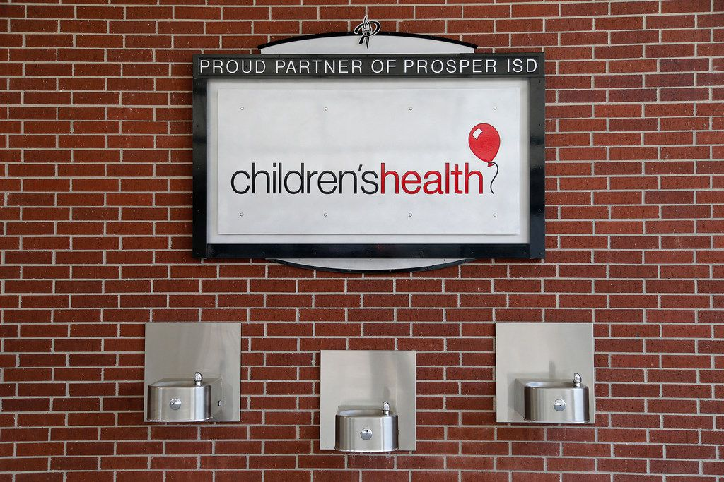 A Children's Health sign is visible in the concourse at Children's Health Stadium, which opens when Prosper plays Rowlett at 7 p.m. Friday.
