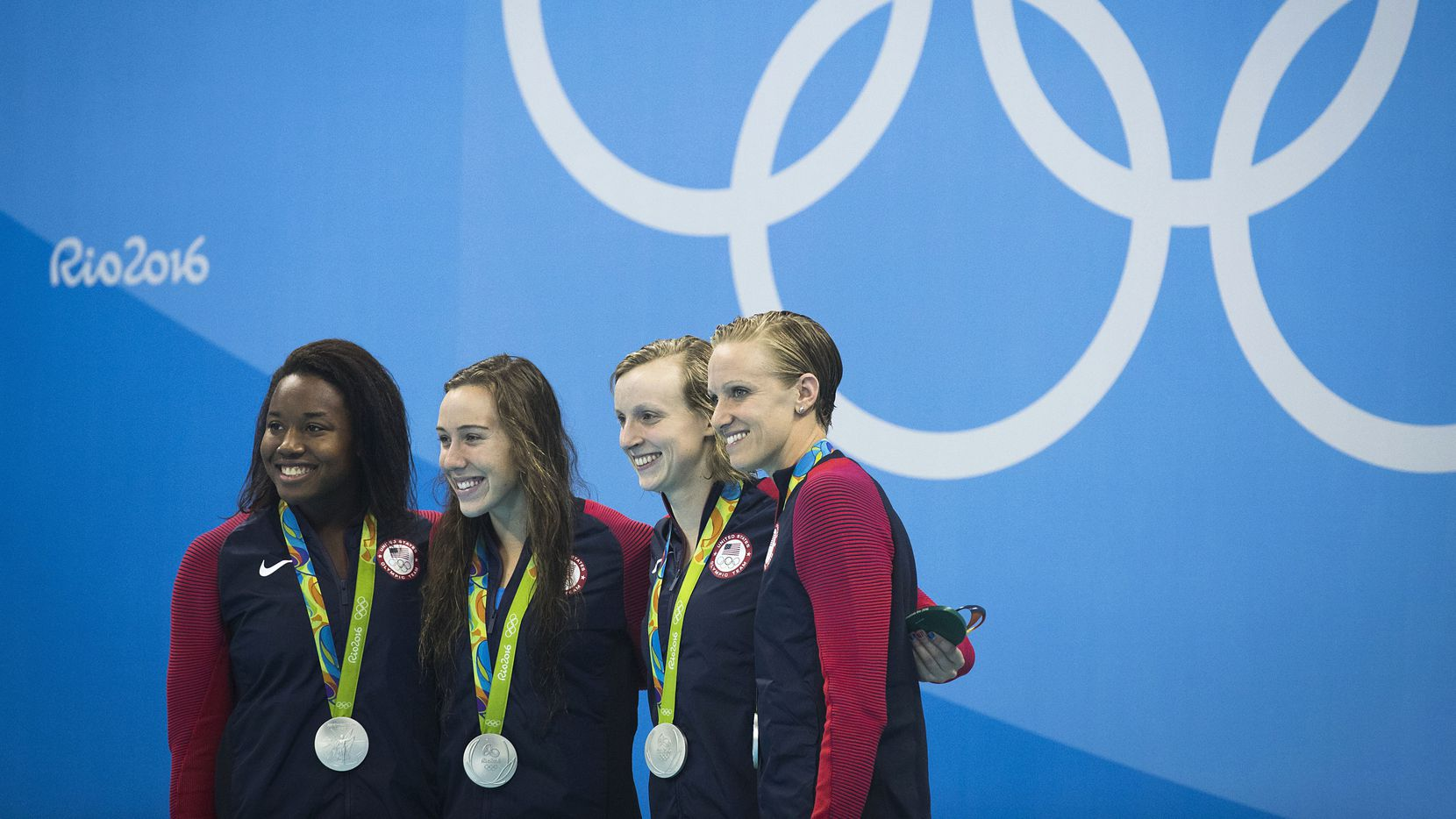 Team USA, from left, Simone Manuel, Abbey Weitzeil, Katie Ledecky and Dana Vollmer pose with their medals after taking silver in the women's 400x100 freestyle relay final at the Rio 2016 Olympic Games on Saturday, Aug. 6, 2016, in Rio de Janeiro.  Australia took the gold. (Smiley N. Pool/The Dallas Morning News)