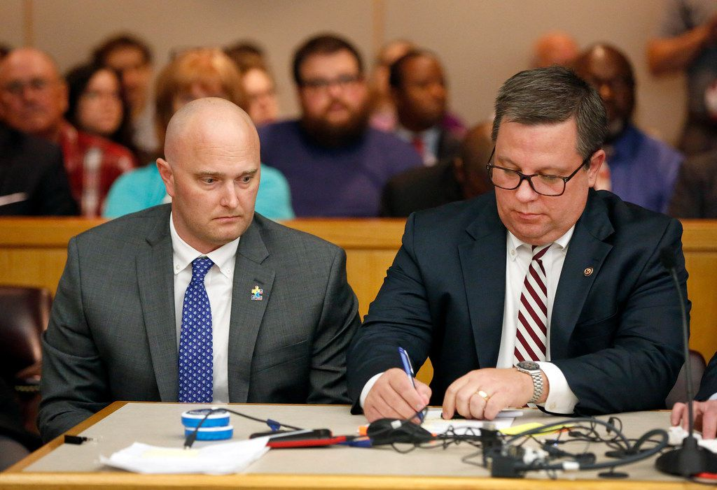 Roy Oliver confers with his attorney Miles Brissette in the courtroom Tuesday.
