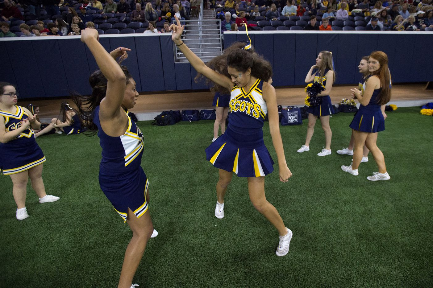 Highland Park cheerleaders Sarah Klein, right, and Brielle Robertson, left, dance before the start of a high school football area-round playoff game against Frisco Independence on Friday, Nov. 18, 2016, at the Ford Center at the Star in Frisco.