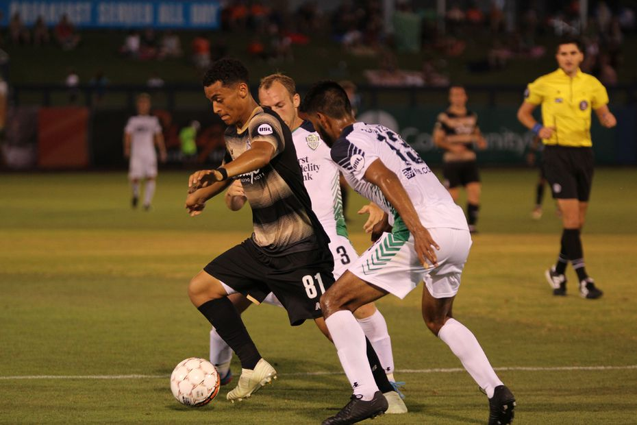 Brandon Servania (#81 in black) of FC Dallas playing on loan with Tulsa Roughnecks of the USL.