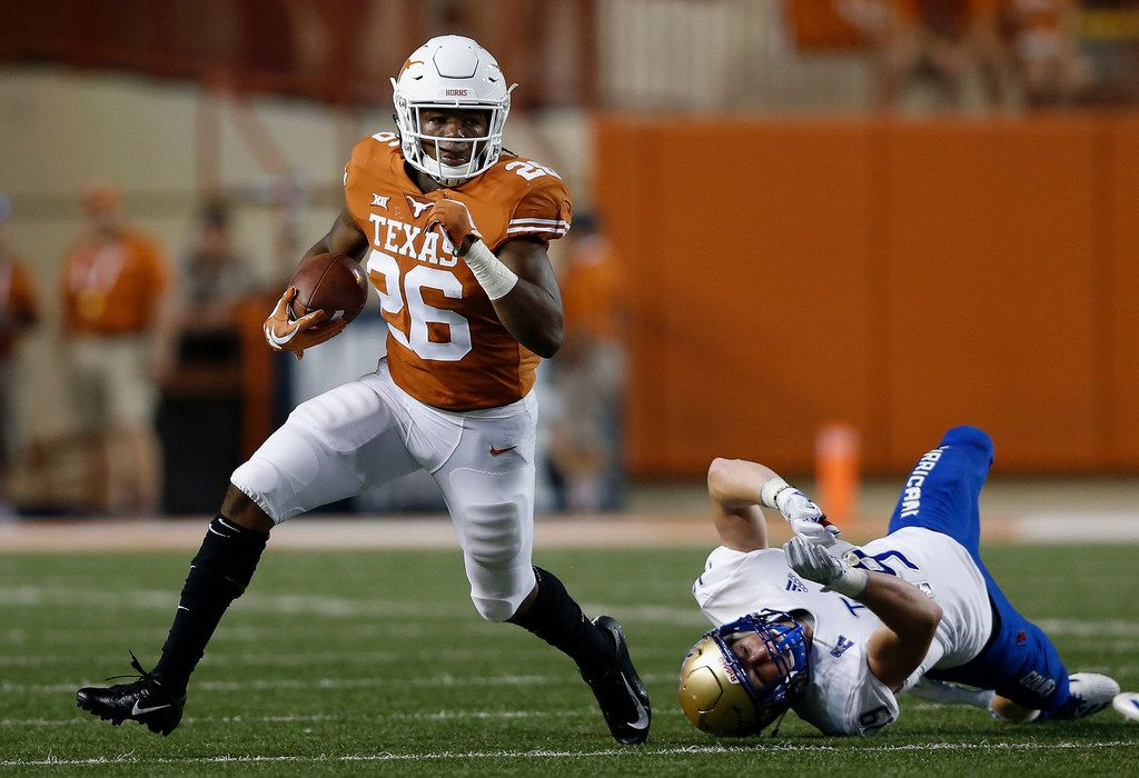 AUSTIN, TX - SEPTEMBER 08:  Keaontay Ingram #26 of the Texas Longhorns breaks a tackle by Grant Sawyer #19 of the Tulsa Golden Hurricane in the second half at Darrell K Royal-Texas Memorial Stadium on September 8, 2018 in Austin, Texas.  (Photo by Tim Warner/Getty Images)