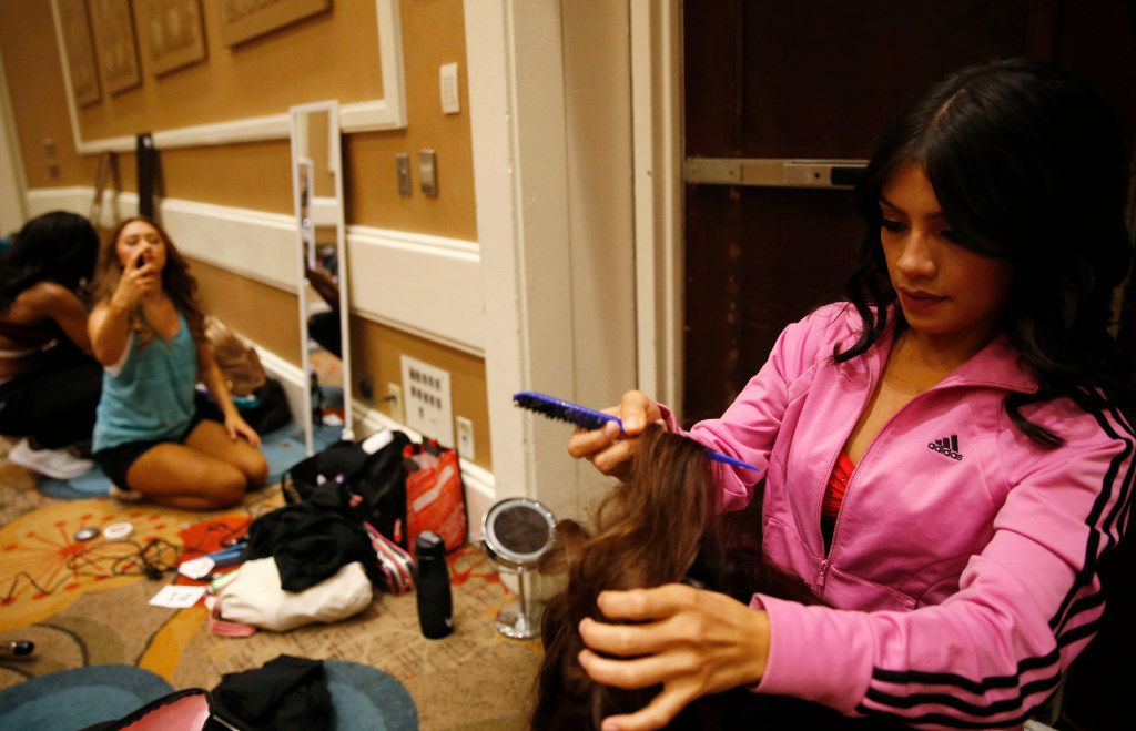 Laura Perales of McAllen, Texas finishes up the hair of Nallely Cazares of San Juan, Texas during the first day of the Dallas Mavericks Dancers auditions at the Hilton Anatole in Dallas on Saturday, July 15, 2017.