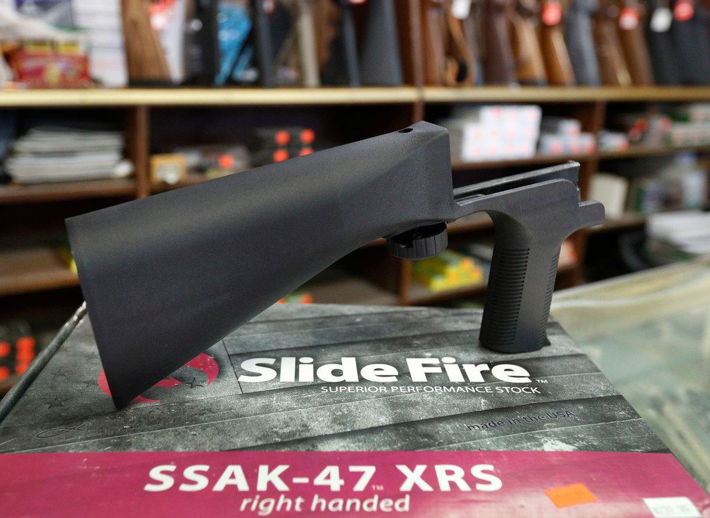 A bump stock device, made by Slide Fire, that fits on a semi-automatic rifle to increase the firing speed, making it similar to a fully automatic rifle, sits on its packaging at a gun store on October 5, 2017, in Salt Lake City, Utah. Calls to ban the device erupted after its use in the Las Vegas concert shooting four days earlier.