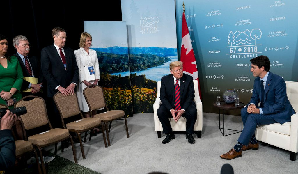 """FILE -- President Donald Trump and Prime Minister Justin Trudeau of Canada at the G-7 summit meeting in Charlevoix, Quebec, Canada, June 8, 2018. To the chagrin of Canadians, Trump has berated their country over its treatment of the United States, particularly its dairy farmers, and rebuked Trudeau as """"dishonest"""" and """"weak"""" after the Group of 7 gathering. (Doug Mills/The New York Times)"""