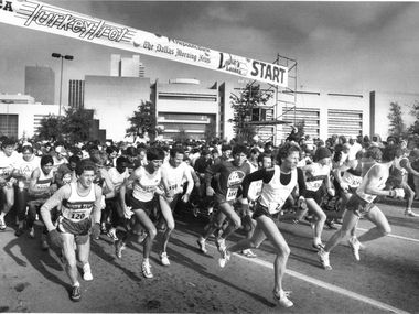 Runners in the Turkey Trot start the race near City Hall. Stan Vernon, winner of the race (#2) is just to the right of the center of the photo. Taken November 11, 1985.