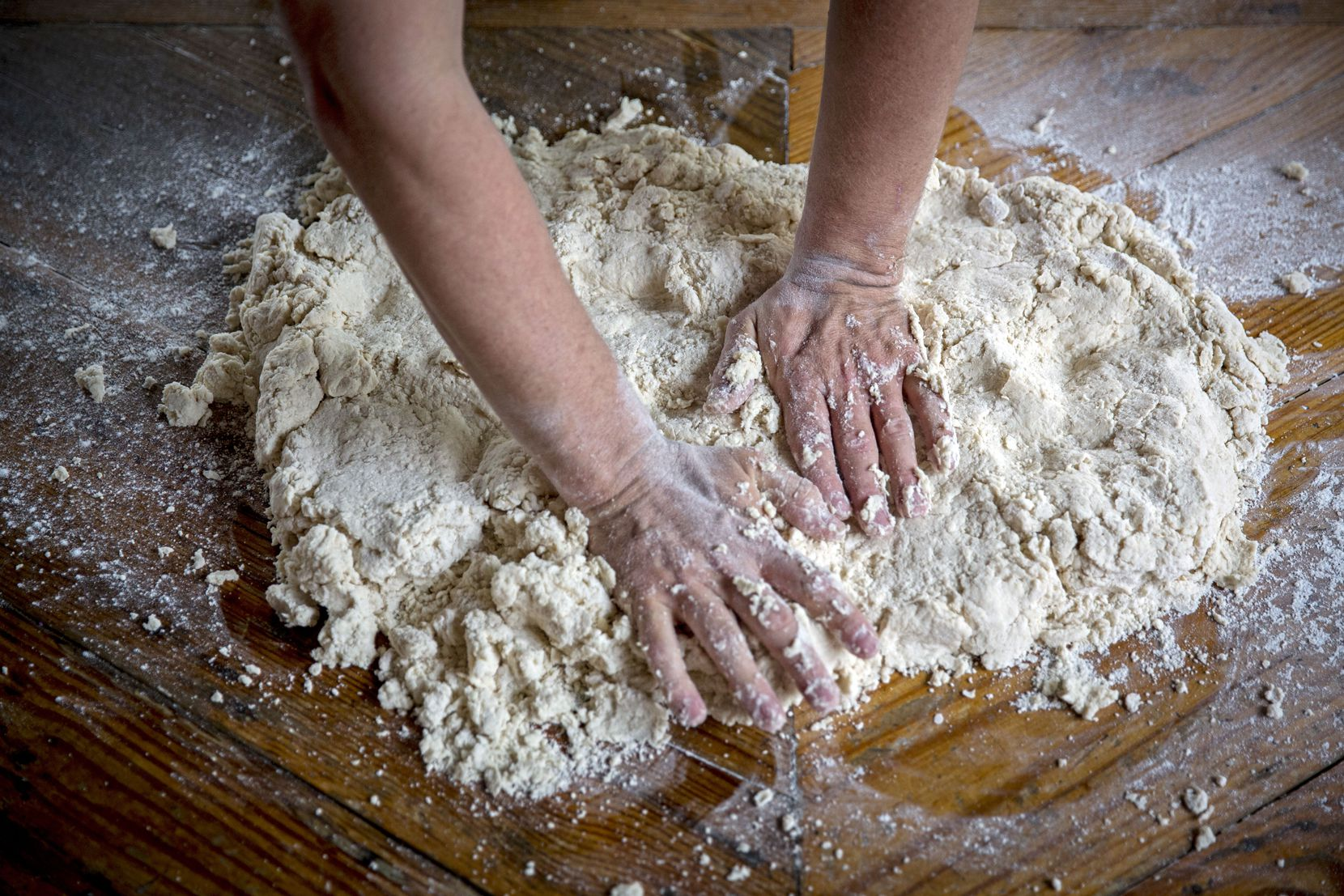 Chef Tim Byres flattens dough he makes buttermilk biscuits at Chicken Scratch restaurant.