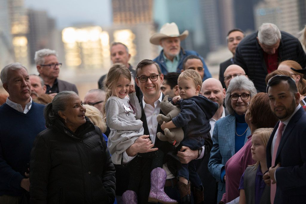 Dallas City Council member Scott Griggs held his children, Catalina and Francisco, during a campaign photo shoot at D.E.C. on Dragon St.