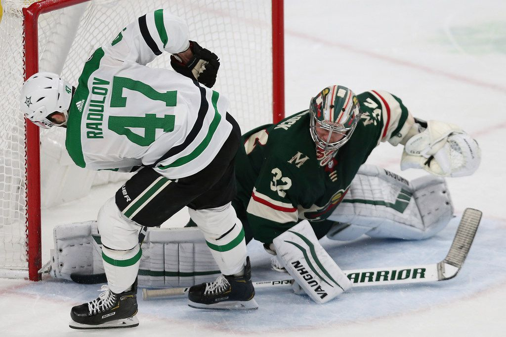 Minnesota Wild's goalie Alex Stalock, right, blocks a shot by Dallas Stars' Alexander Radulov, left, of Russia, in a shootout in an NHL hockey game Sunday, Dec. 1, 2019, in St. Paul, Minn. (AP Photo/Stacy Bengs)
