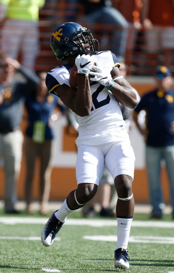 West Virginia Mountaineers wide receiver Gary Jennings (12) catches a kickoff against Texas Longhorns in the first half at Darrell K RoyalÐTexas Memorial Stadium in Austin Nov. 12, 2016. (Nathan Hunsinger/The Dallas Morning News)