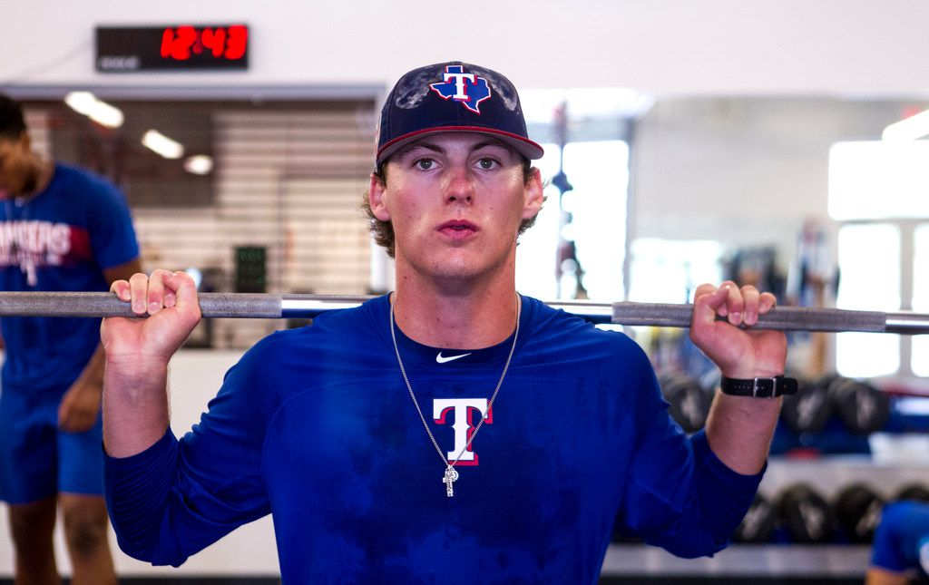 Texas Rangers' pitcher Mason Englert does squats at the Rangers' training facility Thursday, Aug. 9, 2018 in Surprise, Arizona. Englert and other pitchers are learning from a program that is designed to hopefully prevent injury.(Darryl Webb/Special Contributor)