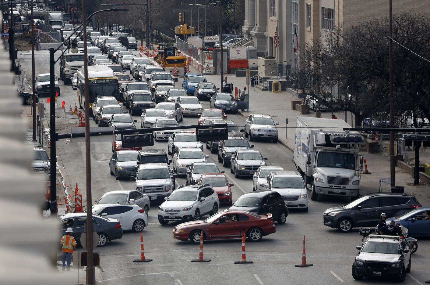 Backed up traffic along eastbound Commerce St. is detoured onto Pearl Expressway because of a ruptured gas line and fire along Cesar Chavez Blvd at Main St. in downtown Dallas, Friday, March 10, 2017.