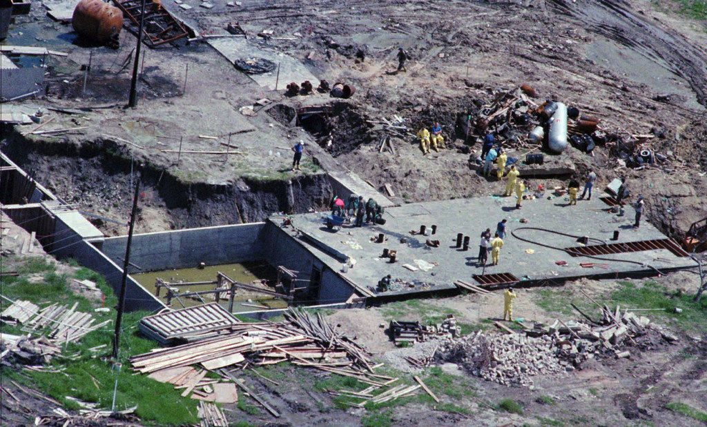 Investigators work on top of the underground bunker at the Branch Davidian compound. (AP photo)