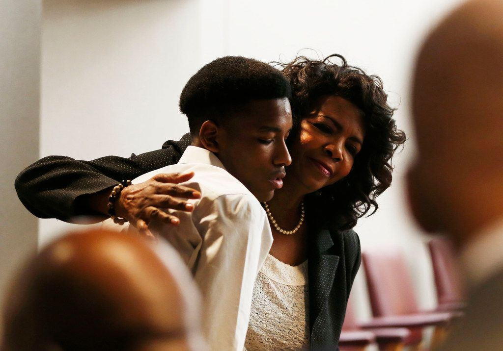 District Attorney Faith Johnson hugs Kevon Edwards, the older brother of Jordan Edwards, during the trial of former Balch Springs police officer Roy Oliver.