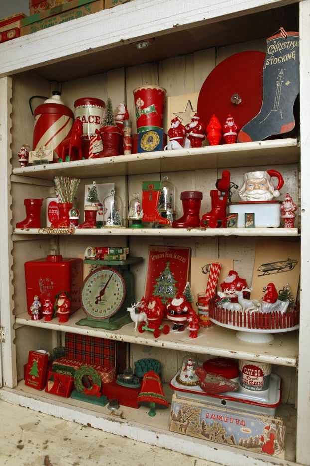 Vintage Christmas decorations collected by Jason McDaniel are displayed at his home in Dallas, Wednesday, Dec. 8, 2010. Many items are displayed in this cupboard.