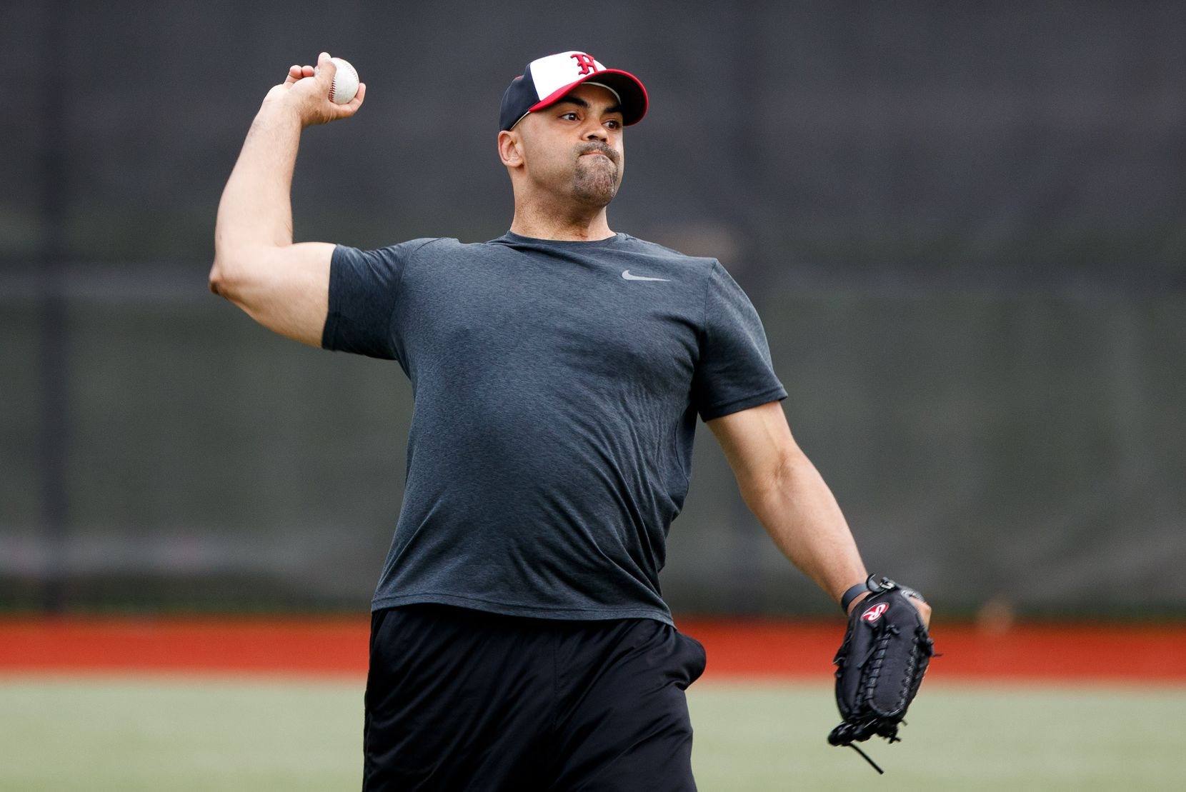 Rep. Colin Allred, D-Texas, a member of the Democratic Congressional Baseball team, throws the ball during practice on June 20, 2019 in Washington, District of Columbia.
