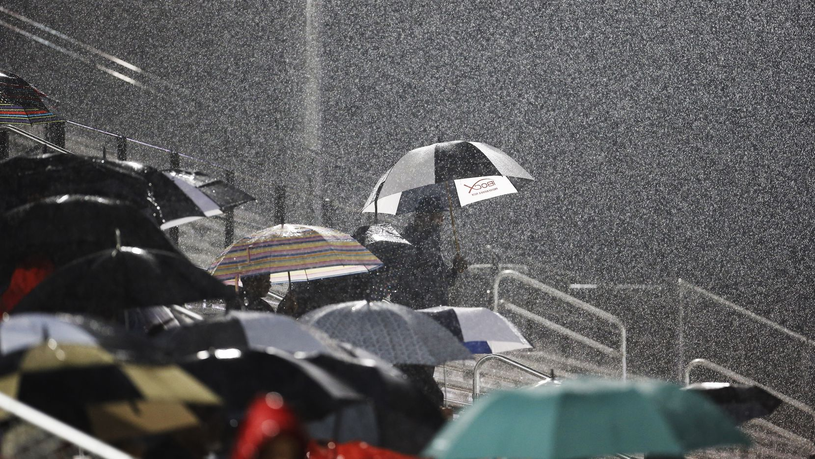 Cedar Hill fans looked on as a heavy rain fell during the first half of a high school football game against Mansfield Summit at R.L. Anderson Stadium in Mansfield on Oct. 12, 2018.