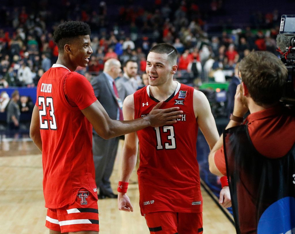 Texas Tech Red Raiders guard Matt Mooney (13) and Texas Tech Red Raiders guard Jarrett Culver (23) celebrate after defeating Michigan State Spartans during the second half of play in the semifinals of the Final Four NCAA college basketball tournament at U.S. Bank Stadium in Minneapolis on Saturday, April 6, 2019. Texas Tech Red Raiders defeated the Michigan State Spartans 61-51. (Vernon Bryant/The Dallas Morning News)