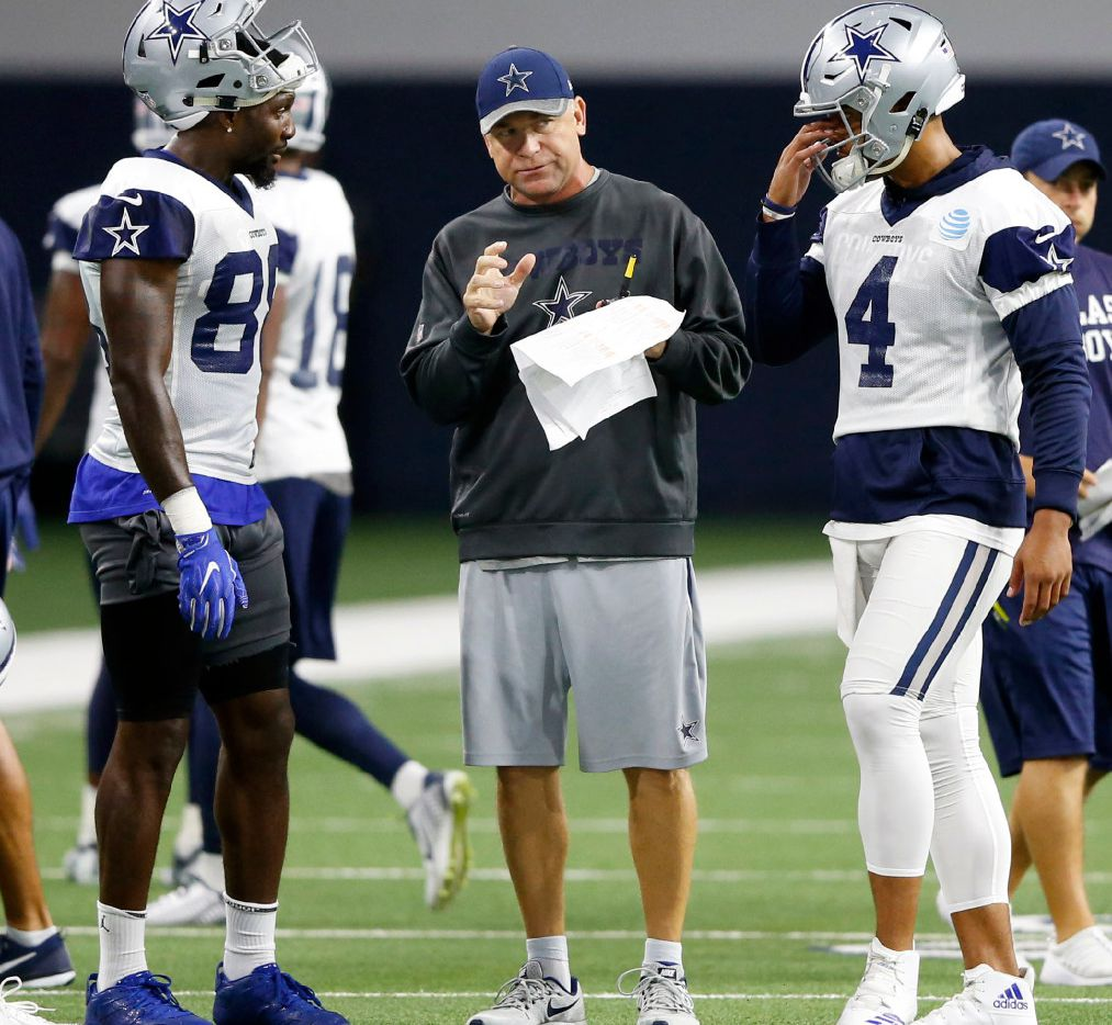 FILE - Cowboys offensive coordinator Scott Linehan talks to wide receiver Dez Bryant (88) and quarterback Dak Prescott (4) during training camp at The Star in Frisco on Thursday, Aug. 24, 2017. (Vernon Bryant/The Dallas Morning News)
