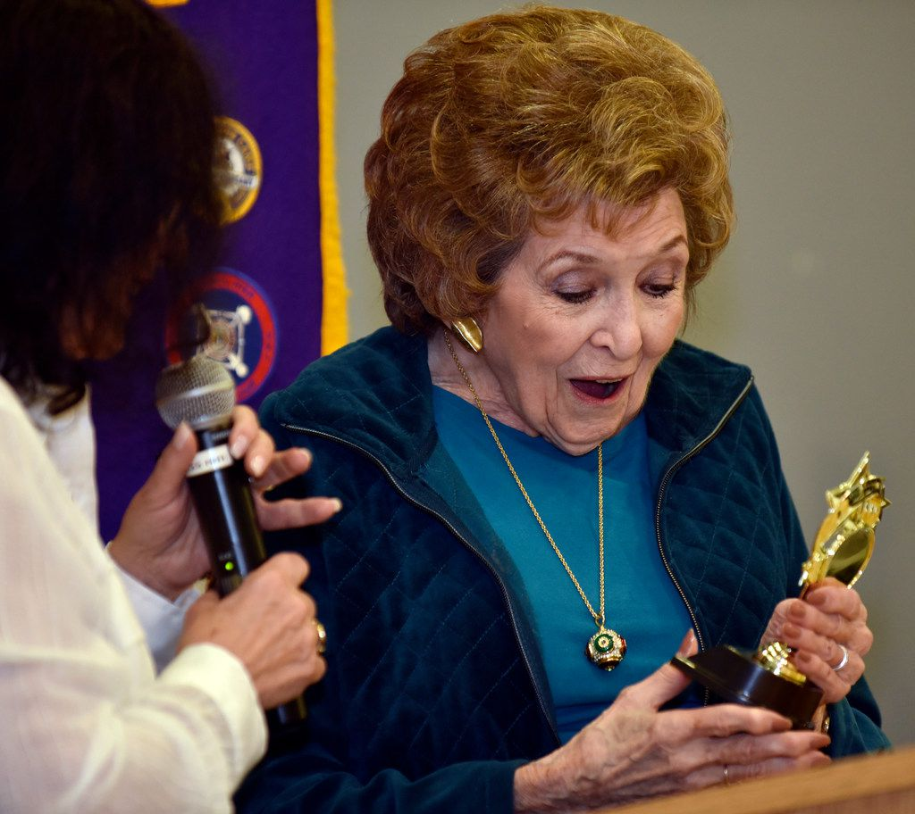 "Bobbie Wygant, 92, reacts as she receives a memento for speaking at the Oak Cliff Lions Club's weekly luncheon on Dec. 18 in Dallas. Wygant, longtime entertainment reporter for NBC 5, spoke about her book ""Talking to the Stars"" and signed copies for fans. Throughout her long career, she's interviewed celebrities such as Debbie Reynolds, Jane Fonda, Paul McCartney and Bradley Cooper."