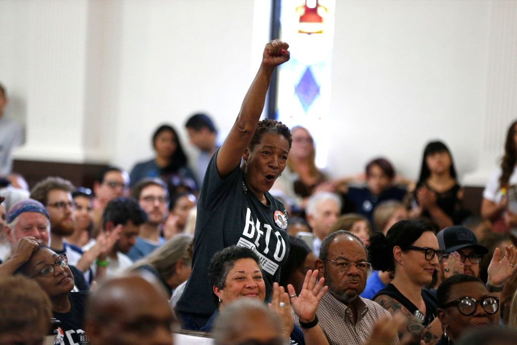 Audience members cheer as Beto O'Rourke speaks to the crowd during the South Dallas with Beto! event at Good Street Baptist Church in Dallas on Sept. 14, 2018.  (Nathan Hunsinger/The Dallas Morning News)