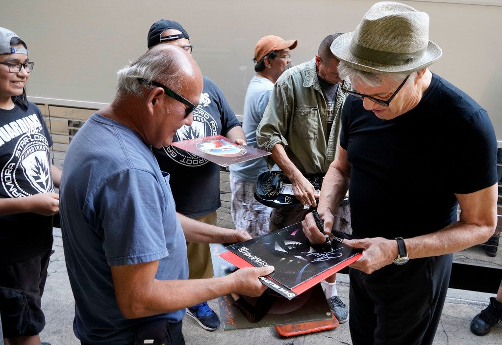 Steve Miller of the Steve Miller Band signs old record album covers and a guitar for his fans by his bus before his concert at the Majestic Theatre in San Antonio, Texas, Wednesday, July 25, 2018. Steve is currently on his 50th Anniversary Tour and will perform at Allen Event Center in Allen on Friday, July 27, 2018. (David Woo Photo)