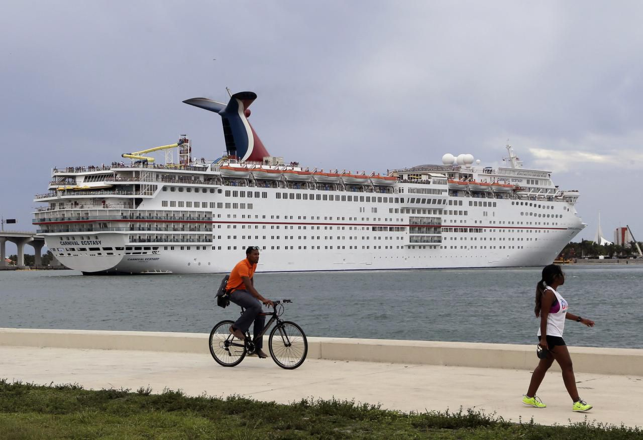 A Carnival Cruise ship sits docked in Cuba.