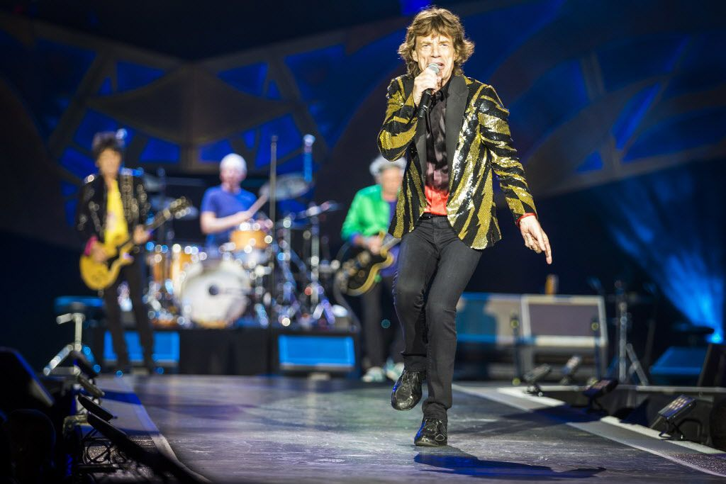 Mick Jagger wore several memorable outfits during the show, including a see-through black top and a feathered red cape.