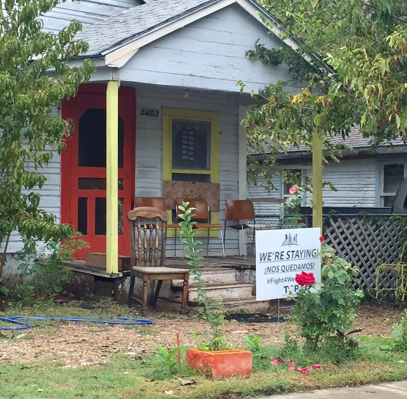 This HMK house on Rutz Street is one of many with signs that say they are staying since an agreement was reached pausing evictions. The signs were supplied by the Texas Organizing Project, or TOP, an advocacy group tackling housing to immigration issues. (Dianne Solis/Staff)