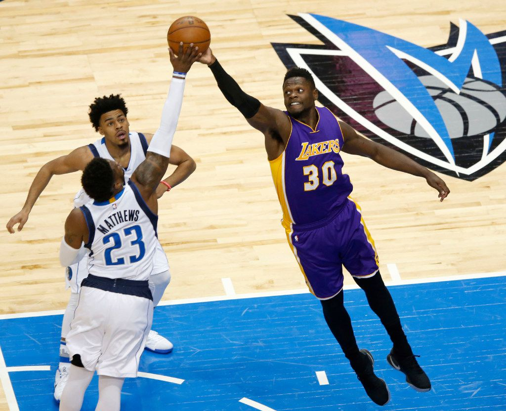 Dallas Mavericks guard Wesley Matthews (23) and Los Angeles Lakers forward Julius Randle (30) go after a loose ball as Dallas Mavericks guard Quinn Cook (2) closes in on the play during the first quarter of play at American Airlines Center in Dallas on Tuesday, March 7, 2017. (Vernon Bryant/The Dallas Morning News)