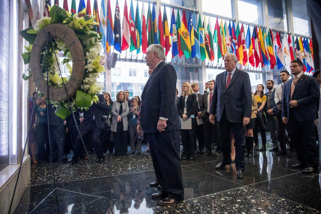 Secretary of State Rex Tillerson, center, accompanied by State Department Undersecretary for Political Affairs Tom Shannon, center right, stops a memorial wall plaques in the lobby of the State Department that honors employees who have given their lives in the line of duty. (AP Photo/Andrew Harnik)