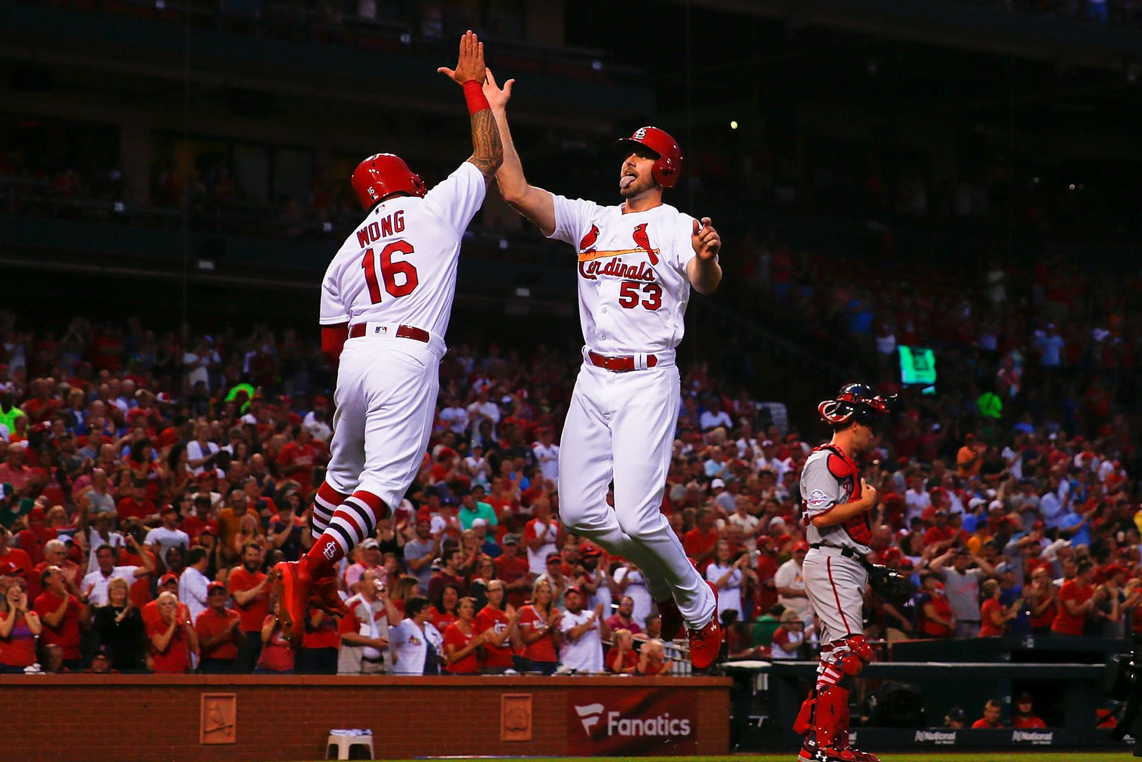 John Gant (right) of the St. Louis Cardinals celebrates after hitting a two-run home run against the Washington Nationals in the second inning at Busch Stadium on Tuesday, Aug. 14, in St. Louis, Mo.
