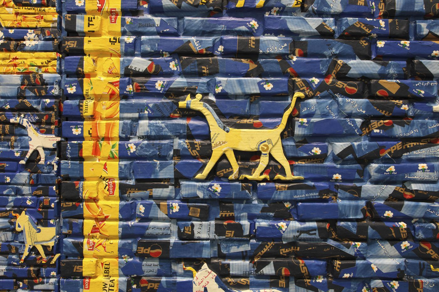 May the Arrogant Not Prevail (detail), 2010Found Arabic packaging and newspapers, glue, cardboard, and wood Collection Museum of Contemporary Art Chicago, gift of Marshall Field's by exchange, 2015.4 Image courtesy of the artist and Rhona Hoffman Gallery