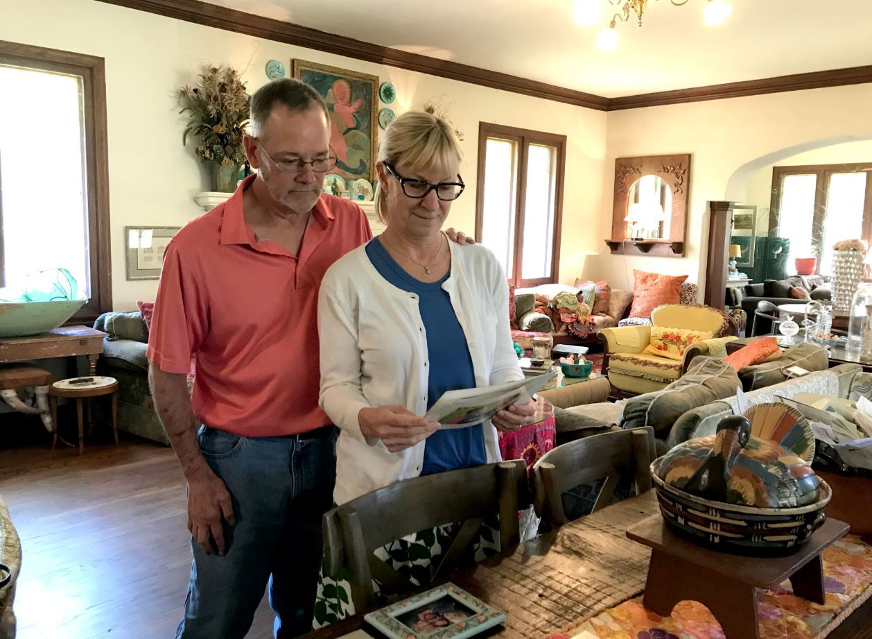 Doug McSwane and Mary Mozelle McSwane look at photos of their son Patrick, who took his life in 2012. His suicide propelled the McSwanes to raise awareness of suicide in Tyler.