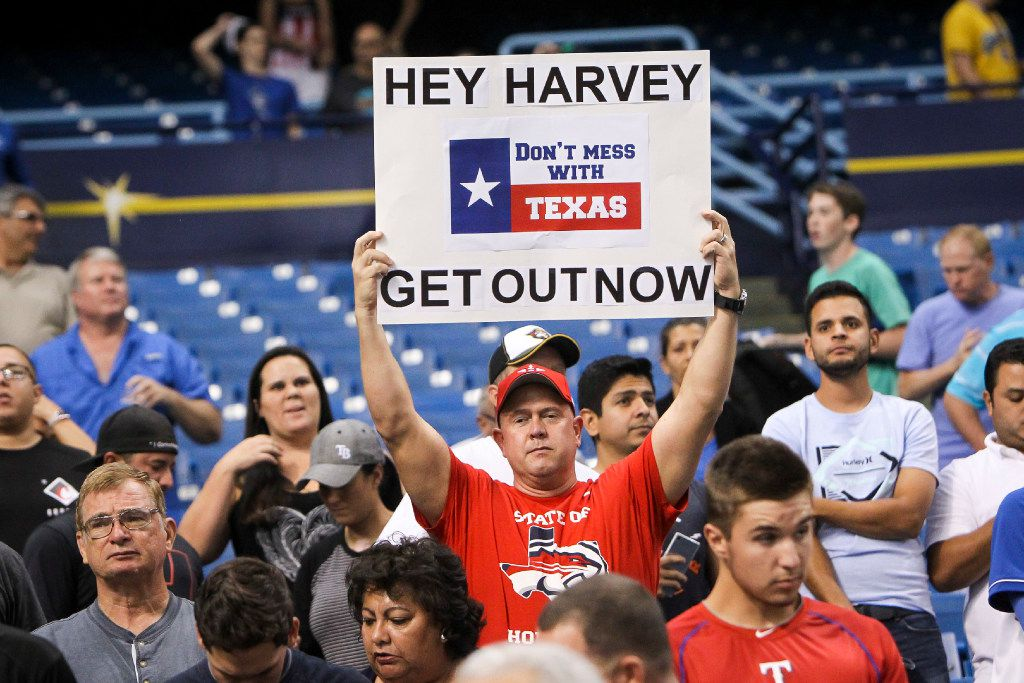 Fans show support for the people of Houston dealing with the effects of Hurricane Harvey during the game between the Texas Rangers and the Houston Astros at Tropicana Field in St. Petersburg, Fla., on Tuesday, Aug. 29, 2017. The Astros are using the Tampa Bay Rays' home park due to flooding in Houston. (Will Vragovic/Tampa Bay Times/TNS)