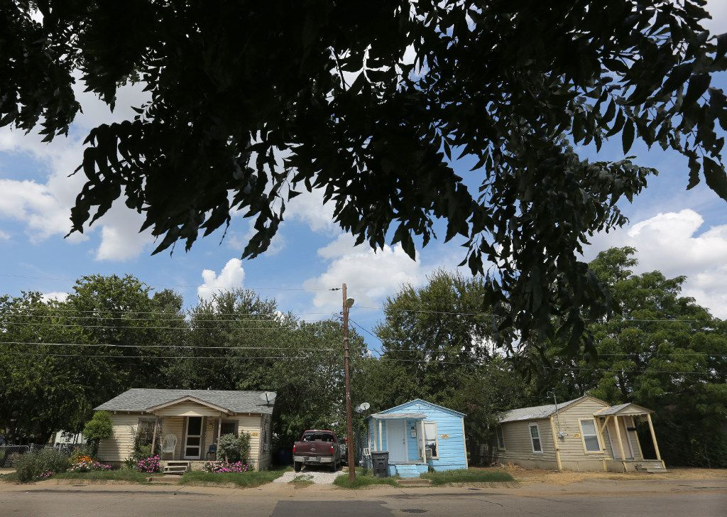 Three houses on Nomas Street in West Dallas, all owned by HMK.