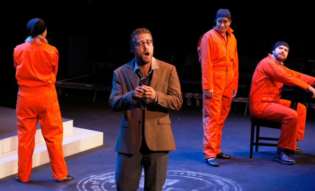 Trevor Martin (front), baritone, as Dr. Milton, performs with Anna Laurenzo (left), mezzo,Christina Pecce, soprano, and Andrew Surrena, tenor. (David Woo/Staff Photographer)