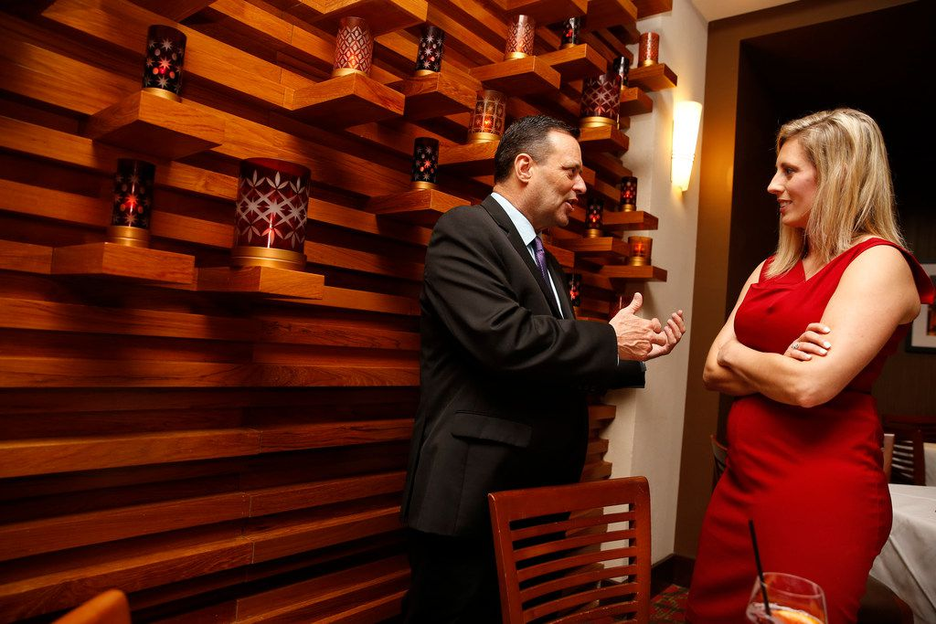 Ericka Downey (right) talks to Texas Tech coach Billy Gillispie talk during a Final Four party for coaches at Ruth's Chris at the Grand Hyatt Riverwalk in San Antonio, Texas on March 30, 2017.  Ericka Downey, the Oklahoma mother of two and wife of Northeastern State University basketball coach Mark Downey, told The Dallas Morning News that she received confirmation Thursday from the Mayo Clinic that she will be able to donate one of her kidneys to Billy Gillispie. (Nathan Hunsinger/The Dallas Morning News)