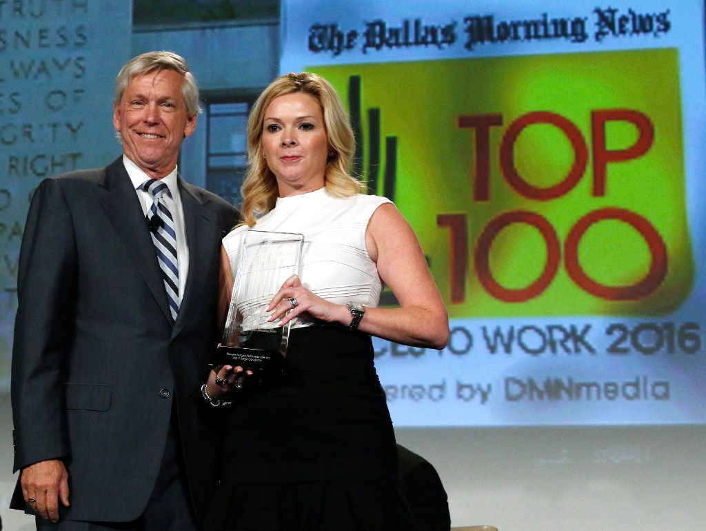 Jim Moroney, Publisher and CEO of the Dallas Morning News, left, with Teresa Fairbrook, VP & Chief Human Resources Officer, Pioneer Natural Resources, accepts the award for best large company at the Top 100 Place to Work luncheon at the Dallas Omni Hotel on Friday, November 17, 2016 in Dallas, Texas. (David Woo/The Dallas Morning News)