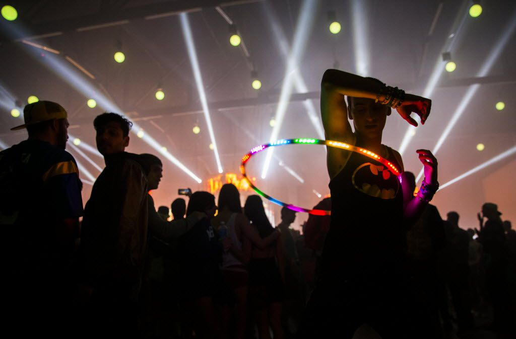Zach Lambert of Tampa, Florida hula hoops during the Lights All Night New Year's Eve party on Thursday, December 31, 2015 at Dallas Market Hall in Dallas.