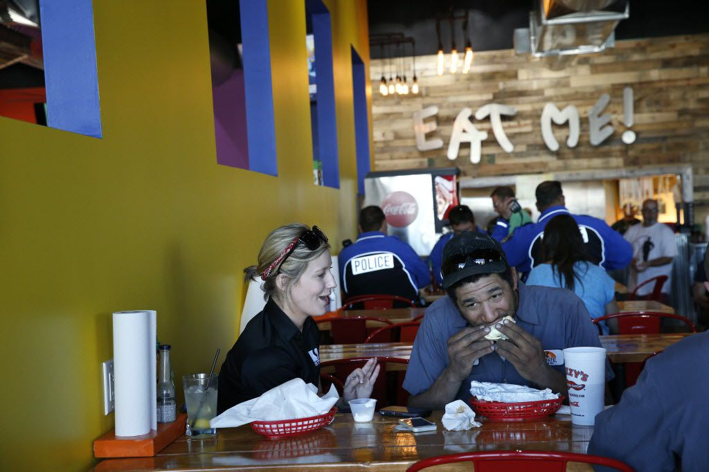 Bridgette Johns (left) and Devon Manning eat at Fuzzy's Taco Shop in Frisco March 1, 2016. (Nathan Hunsinger The Dallas Morning News)